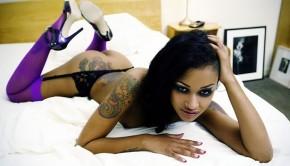 Beautiful tattooed ebony squirting a lot