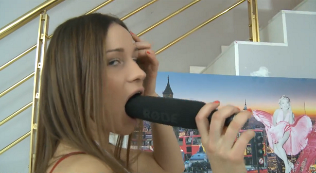 Interesting. Tell Girl gives blowjob to microphone