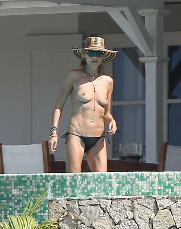 Heidi Klum goes topless on her Caribbean holiday