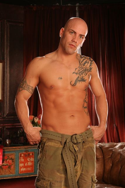 1386602561-derrick_pierce_combat_pants_shirtless_cock_star_pon_male_tattoos_bald_bady_boy