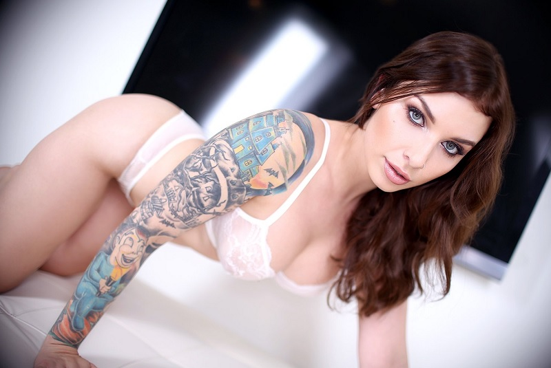 Inked up beauty sure loves getting tit fucked